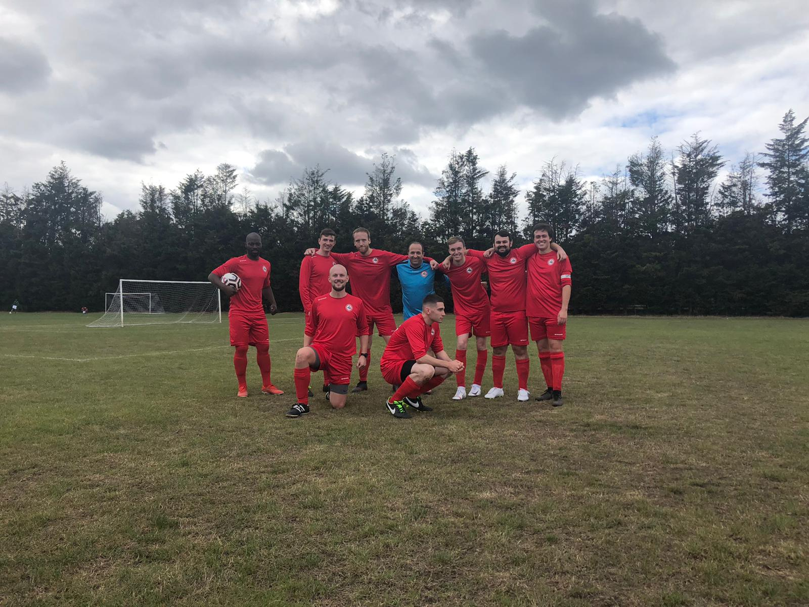 A team photo of my sunday league football team, several pulling silly faces or poses.